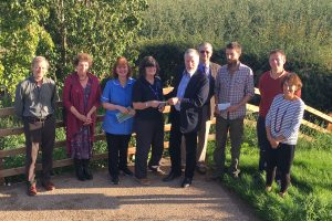 Adam Munthe presents a donation to St Michael's Hospice